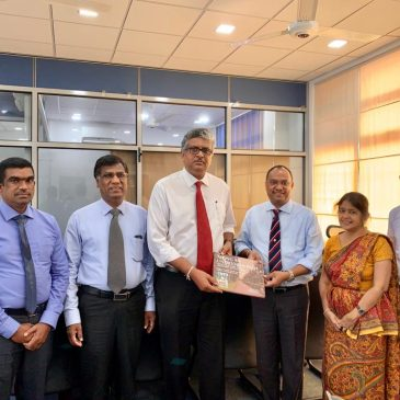 Presenting 'Along an Untrodden Path' to the Chairman of University Grants Commission